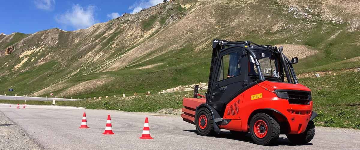 Forklift on a street in the Alps